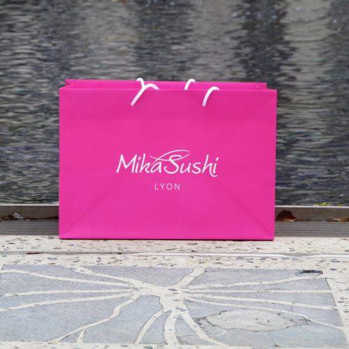 Mika sushi's bag around water